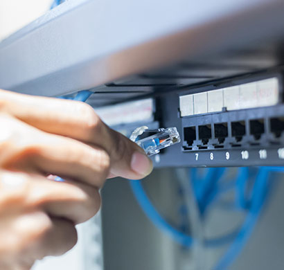 hand patching blue ethernet cable