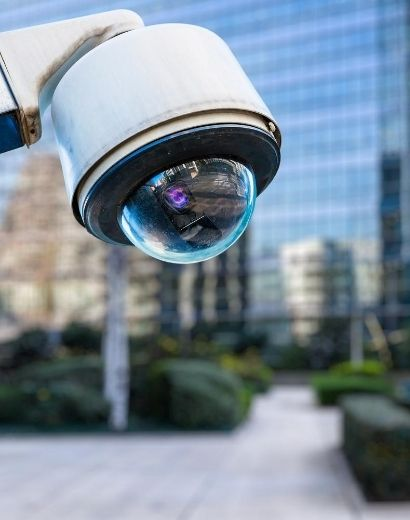 security CCTV camera with blurry building in background