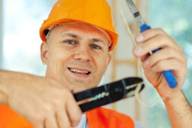 Cabling installer crimping ethernet cable